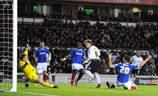 Derby County's Kris Commons scores against Portsmouth.