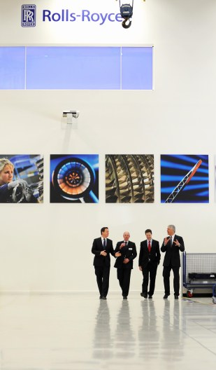 David Cameron, director John Griffiths, chief executive, John Rose and Nick Clegg at Rolls-Royce shortly before a cabinet meeting.
