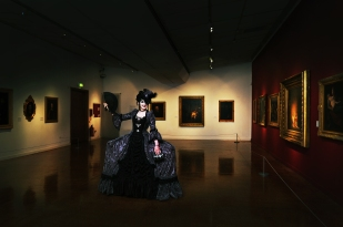 An artist shows off her work at Derby Art Gallery.