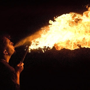 A fire breather at a beach party during Whitby's biannual Goth Festival.
