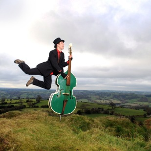 Giles Robinson pictured practicing his double bass at Alport Heights in Derbyshire.