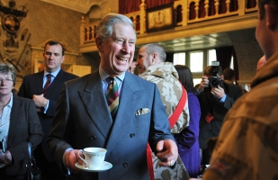 Prince Charles has a cup of tea and a chat with troops at Sandringham.