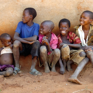 Boys living in a Tanzanian leper village where people are without adequate food, shelter or medicine.