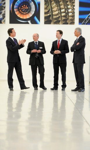 David Cameron and Nick Clegg with Rolls-Royce director John Griffiths, and chief executive John Rose.