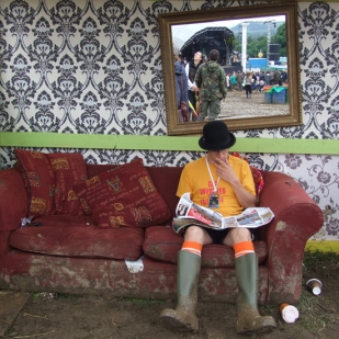 Taking a break from the mud at Glastonbury Festival.