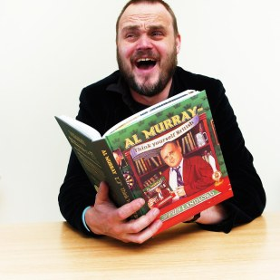 "Comedian Al Murray with his book, ""Think Yourself British""."