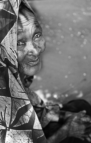 "A blind woman living in a ""plague village"" in Tanzania."