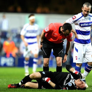 QPR's Paddy Kenny sustains an injury.