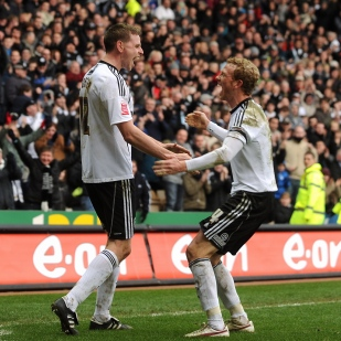 Derby County's Chris Porter and Paul Green celebrate their goal against Watford.