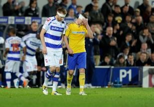 QPR's Kaspars Gorkss and Derby's Steve Davies nurse their wounds.