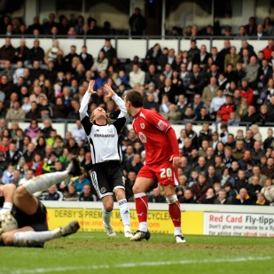 Derby County's Robbie Savage laments a save by Bristol City's Adriano Basso.