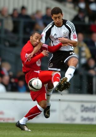 Derby County's Lewin Nyatanga takes on Bristol City's Nicky Maynard.