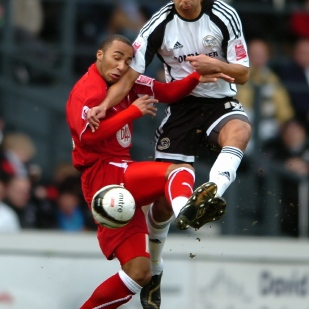 Derby County's Lewin Nyatanga takes on Bristol City's Nicky Maynard.