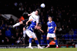 Derby County's Shaun Barker wins a header against Ipswich.