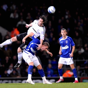 Derby County's Shaun Barker wins a header against Ipswich.